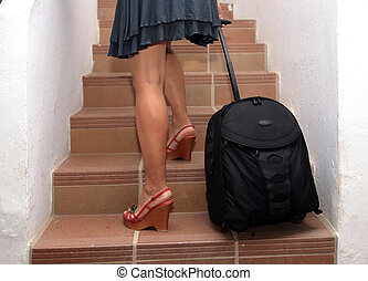 travelling woman going upstairs