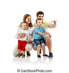 Happy family in studio - Portrait of the happy family with...