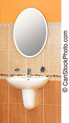 Basin and mirror - Modern wash basin and oval mirror in...