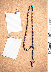 rosary beads on cork board - the rosary beads on cork board