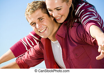 young couple - a couple playing and laughing