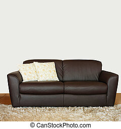 Brown sofa - Brown leather sofa with two floral pillows