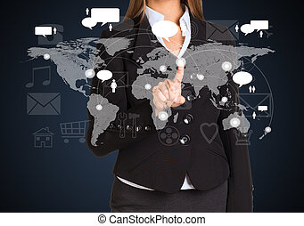 Businesswoman in a suit presses the virtual world map with...