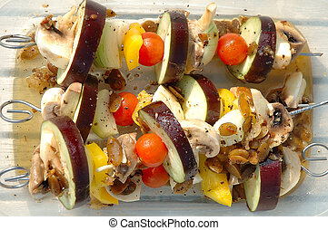 barbecue - vegetarian shish-kebab prepared for cooking on...