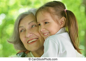 Grandmother with her granddaughter for a walk