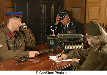 mature general on the table with soldiers - Military mature...