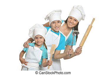 Smiling female chef with assistants isolated on white...