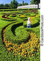 little girl in Flower garden of Kromeriz Palace, Czech...
