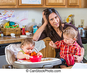 Stressed Out Mother - Stressed out mother in kitchen with...