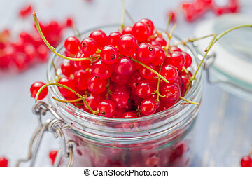 red currant fruit jar wooden table - Red currant fruit in a...