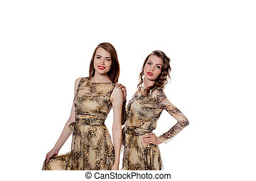 Pretty models posing in dresses from same cloth