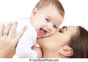 happy mother kissing baby - family, child and parenthood...