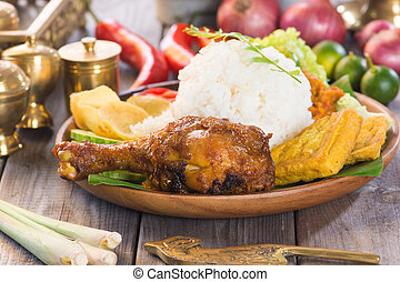 Famous traditional Indonesian food. Delicious nasi ayam...