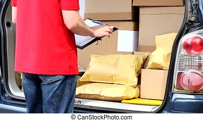 Courier at work - Courier in red uniform at work video