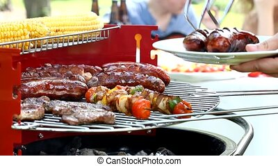 Sausages on barbecue grill - Close-up of a sausages on...