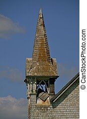 Dilapidated steeple of a church - A steeple of a church is...