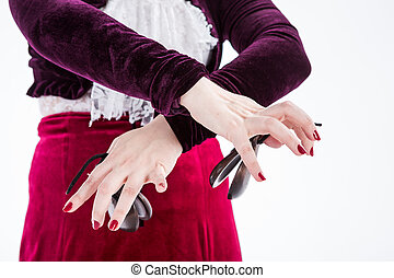 clouse up hands with castanets of a female spanish flamenco...