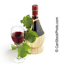 classic Chianti bottle, wineglass and grapevine leaves