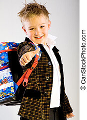 schoolboy - a schoolboy going to school for the very first...