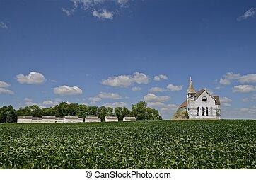 Church, bean field and granaries