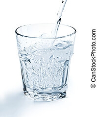 natural spring water - water jet filling a glass on white...