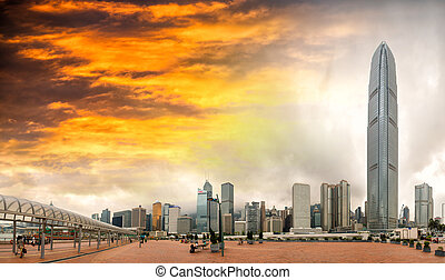 Sunset over Hong Kong. City skyline from the pier