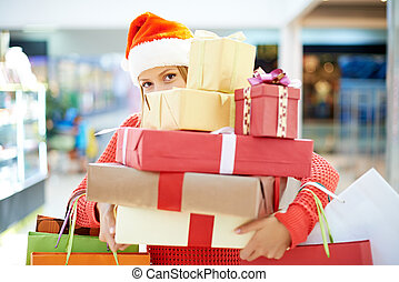 Efficient shopping - Young woman with heap of Christmas...