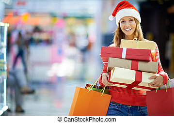 Time for Christmas shopping - Portrait of young woman with...
