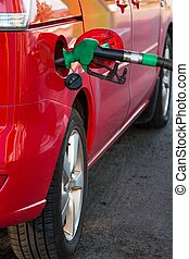 Refuel the car at gas station