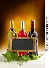 wine list - blackboard hanging on wine bottles and grapevine...
