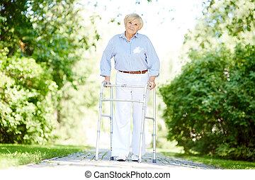Female walking out - Portrait of happy senior patient...