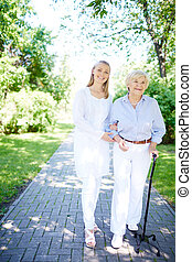 Walking out together - Pretty nurse and senior patient...