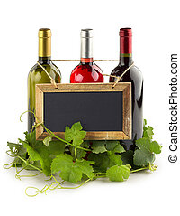 wine cellar - blackboard hanging on wine bottles and...