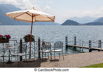 Cafe on promenade in Menaggio, Como lake, Italy