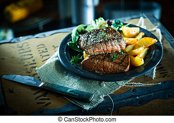 Succulent grilled beef steak and vegetables