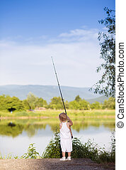 Little girl fishing - Cute little girl fishing on the lake...