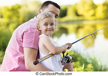 Happy father and daughter fishing - Happy young father...