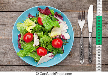 Fresh healthy salad, tomatoes and kitchen utensils - Fresh...