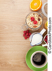 Healty breakfast with muesli, berries, orange juice, coffee...