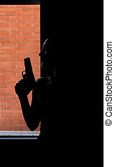 Beautiful Woman with a red dress and a gun - Silhouette of...