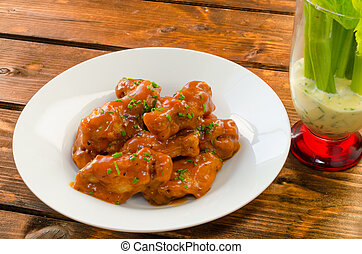 Buffalo chicken hot wings with mayonnaise sauce and celery