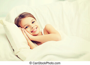 little girl sleeping at home - health and beauty concept -...