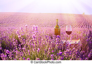 Bottle of wine. - Bottle of wine against lavender landscape.