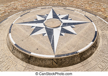 Compass Rose detail - Compass rose placed on the ground in...