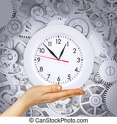 Hand hold clock with gears. Conceptual background