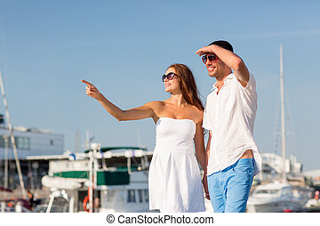 smiling couple in city - love, travel, tourism and people...