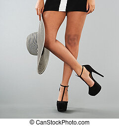 Woman with black high heels - Legs of black woman with high...