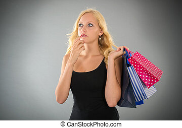 attractive blond woman with shopping bags forgot something -...