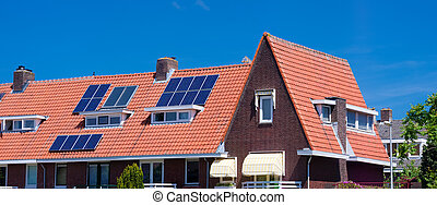 solar panels on roof - solar panels on a red roof in...