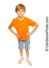 Boy in orange shirt